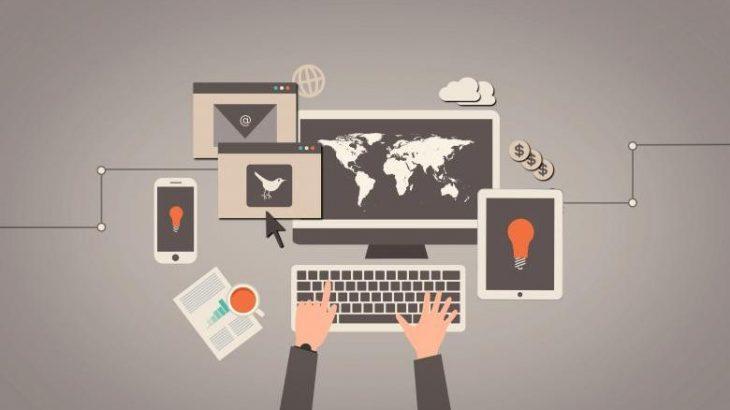 Na imagem, há uma ilustração de um computador, celular, tablet e notebook. Todos conectados e simbolizando a conexão desses dispositivos. Os tons que sobressaem são o cinza e o bege.